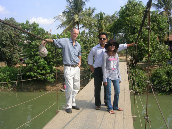 Lom Orng staff inspect the Knach Romeas reservoir